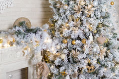 Brightly lit christmas tree with lots of gifts Royalty Free Stock Images