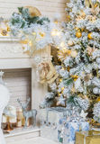 Brightly lit christmas tree with lots of gifts Stock Photography