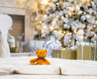 Brightly lit christmas tree with toy bear Stock Images