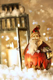 Brightly lit lantern in the snow royalty free stock images