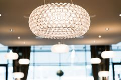 Brightly Lit Round Ceiling Lighting in Restaurant with Blurred B. Ackground stock photography