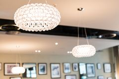 Brightly Lit Round Ceiling Lighting in Restaurant with Blurred B. Ackground stock photo