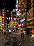 Brightly lit street with numerous billboards and neons in Dotomb Stock Photo