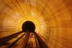 Brightly lit tunnel Stock Images