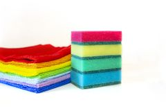 Brightly multicolored cleaning sponges and rags on white background royalty free stock photos