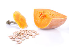 Brightly orange pumpkin with it's seeds Royalty Free Stock Images