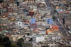 Brightly painted apartments in Quito, Ecuador. Brightly painted apartment buildings on the slope of the valley in a suburb of Quito, Ecuador, seen from the Stock Photography