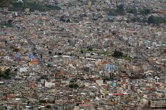 Brightly painted apartments in Quito, Ecuador. Brightly painted apartment buildings on the slope of the valley in a suburb of Quito, Ecuador, seen from the Stock Image