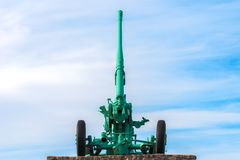 Brightly painted barrel of the antiaircraft defensive gun looking into the sky. Brightly painted barrel of the antiaircraft defensive gun looking into the blue stock photos