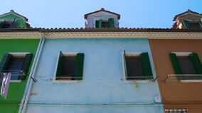 Brightly painted blue house in multicolored street, Burano island architecture. Stock footage stock footage