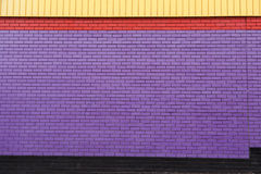 Brightly painted brick wall Royalty Free Stock Photos