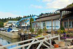 Brightly painted Buildings, Cowichan Bay boat collection. A colourful collection of brightly painted along the boardwalks of the marina area of Cowichan Bay, BC Royalty Free Stock Images