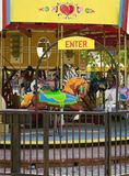 Brightly painted carousel in old town Hanford, California. Bright yellow, pink and gold adorn this attractive carousel near the old Kings County Courthouse in royalty free stock photography