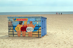 A brightly painted deck chair hut on a beach. The hut contains deck chairs and the owner will rent them out by the hour. this is situated on the beach at Great royalty free stock photography