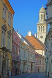 Brightly painted street in the old town sopron Hungary. Brightly painted facades of the buildings in a street in the old town sopron Hungary stock image