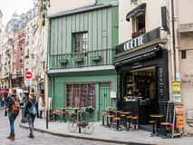 Brightly painted, flower-bedecked cafe Odette in the Latin Quart Royalty Free Stock Photography