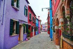 Brightly painted houses at the Burano canal Stock Photography