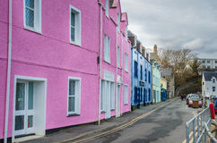 Brightly Painted Houses and Cloudy Sky Royalty Free Stock Images