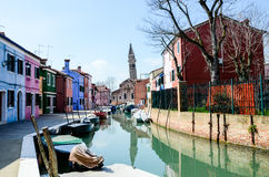 Brightly painted houses, tilted tower in Burano Stock Photo
