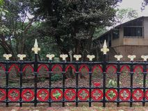 Brightly painted Red Yellow and Black Vintage rot iron compound railing- Matheran Dustrict Raigad Maharashtra INDIA. 25 jun 2019 Brightly painted Red Yellow and royalty free stock image
