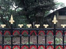 Brightly painted Red Yellow and Black Vintage rot iron compound railing- Matheran Dustrict Raigad Maharashtra INDIA. 25 jun 2019 Brightly painted Red Yellow and royalty free stock photo