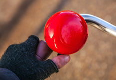 Brightly red classical bicycle bell horn Stock Image