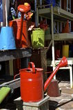 Brightly red painted retro water cans Royalty Free Stock Photography