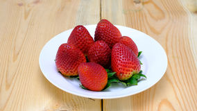 Strawberries on whte poecelain plate Royalty Free Stock Photography