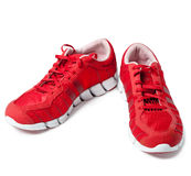 Brightly red trainers. Still-life on a white background Stock Photo