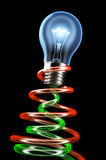Brightly shining light bulb with electrons flow. Stock Photography