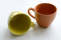 Brightly yellow and orange ceramic cups Royalty Free Stock Image