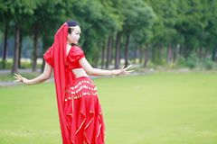 Brightness of dance Asian Chinese belly dancer in red dress Stock Photography