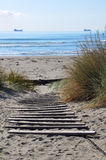 Brighton Beach, Christchurch New Zealand. Pristine Brighton beach, Christchurch New Zealand on a perfect summer morning. Woodem planks provide steps down to the Royalty Free Stock Photo