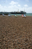 Brighton beach deckchairs palace pier Stock Photo