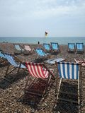 Deck chairs are waiting for sunseekers royalty free stock photography