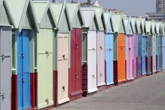 Brighton beach huts. Pastel mini homes on the promenade stock photo