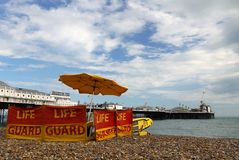 Brighton: beach life guard and pier Stock Photography