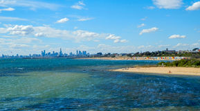 Brighton Beach and Melbourne Skyline. Brighton Beach bathing boxes with the Melbourne city skyline Stock Photography