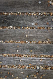 Brighton beach pebbles wooden boards background Stock Image