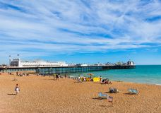 Brighton Beach with Pier, England Stock Images