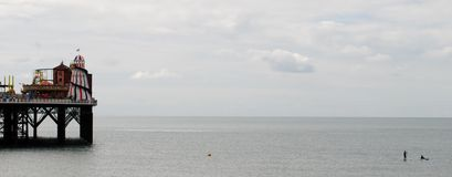 Brighton Beach and Pier.  Paddleboard and Kayak. British summertime 2015.  Brighton beach is a holiday destination for thousands of tourists each year. 2015 has Stock Images
