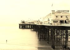 Brighton Beach and Pier.  Swimmer B&W. British summertime 2015.  Brighton beach is a holiday destination for thousands of tourists each year. 2015 has been a bit Stock Image