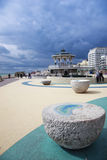 Brighton beach seafront bandstand sussex uk. Stormy sky above victorian bandstand on brighton beach promenade west sussex in england Royalty Free Stock Photos