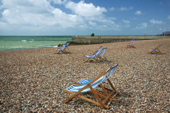 Brighton beach striped deckchairs sussex england Royalty Free Stock Photography