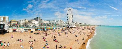 Brighton beach. On sunny day. Panoramic view of the coast of the tourist resort Brighton. August 2014, England royalty free stock photos