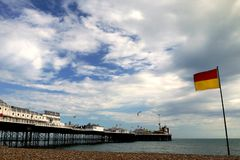 Brighton: beach surf rescue flag and pier Stock Photography