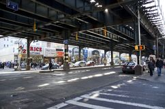 Brighton Beach. The view down Brighton Beach Avenue in Brooklyn in New York City, in shade from the overhead train platform that runs over the street there. The royalty free stock photos