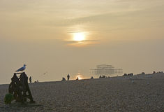 Brighton beach and west pier in mist. East Sussex, England Royalty Free Stock Images