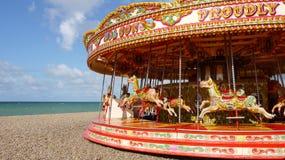 Brighton: carousel on beach panorama. British seaside resort town Brighton; empty carousel on beach - panorama royalty free stock photography
