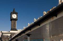 Brighton Clock tower on the pier. The entrance of the pier in Brighton is marked by the clock tower The pier is a playground for kids and main tourist attraction Royalty Free Stock Photo